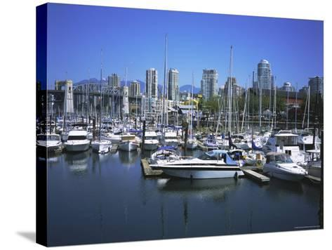 Boats Moored in False Creek by Granville Island with Downtown Vancouver Beyond, Canada-Pearl Bucknell-Stretched Canvas Print