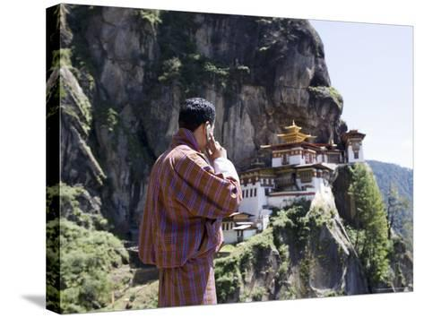Bhutanese Man with Cell Phone, Taktshang Goemba (Tiger's Nest) Monastery, Paro, Bhutan, Asia-Angelo Cavalli-Stretched Canvas Print