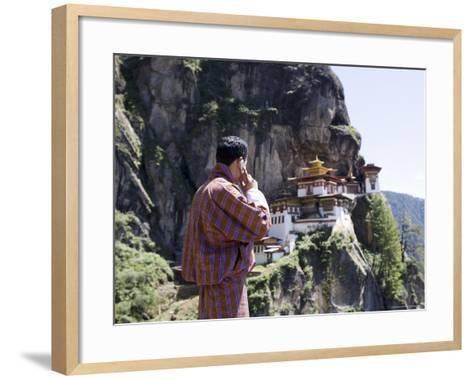 Bhutanese Man with Cell Phone, Taktshang Goemba (Tiger's Nest) Monastery, Paro, Bhutan, Asia-Angelo Cavalli-Framed Art Print