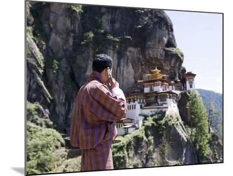 Bhutanese Man with Cell Phone, Taktshang Goemba (Tiger's Nest) Monastery, Paro, Bhutan, Asia-Angelo Cavalli-Mounted Photographic Print