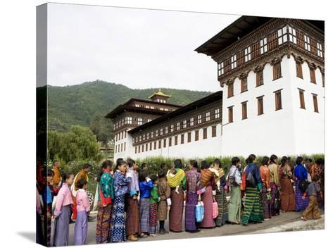 Women Entering Temple for Buddhist Festival (Tsechu), Trashi Chhoe Dzong, Thimphu, Bhutan, Asia-Angelo Cavalli-Stretched Canvas Print