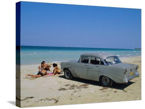 1950s American Car on the Beach, Goanabo, Cuba, Caribbean Sea, Central America-Bruno Morandi-Stretched Canvas Print