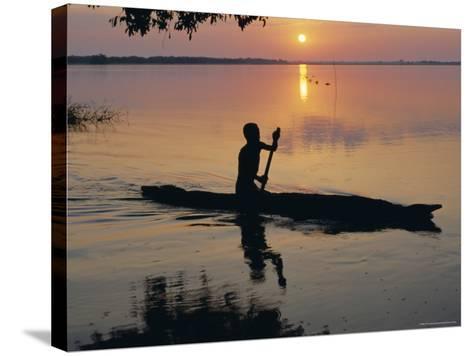Anouak Man in Canoe, Lake Tata, Ethiopia, Africa-J P De Manne-Stretched Canvas Print