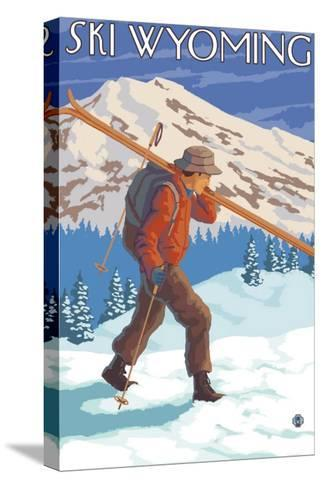 Skier Carrying Snow Skis, Wyoming-Lantern Press-Stretched Canvas Print