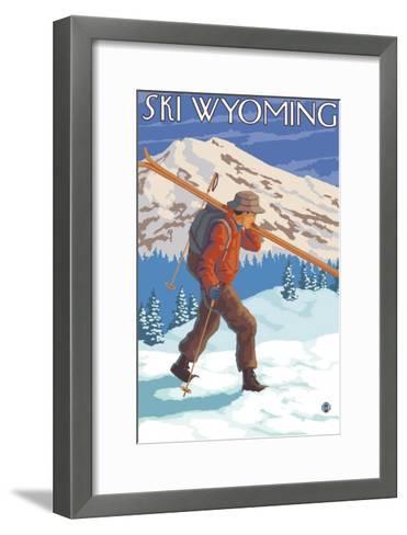 Skier Carrying Snow Skis, Wyoming-Lantern Press-Framed Art Print