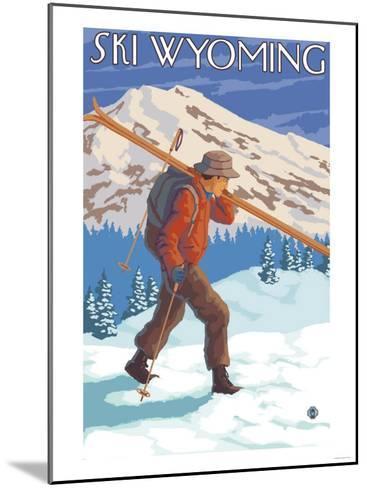 Skier Carrying Snow Skis, Wyoming-Lantern Press-Mounted Art Print