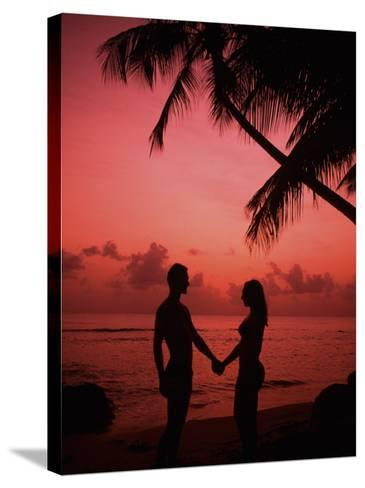 Couple Enjoying a Romantic Sunset on the Beach-Bill Bachmann-Stretched Canvas Print