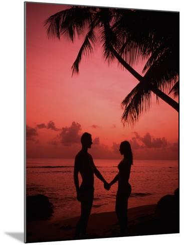 Couple Enjoying a Romantic Sunset on the Beach-Bill Bachmann-Mounted Photographic Print