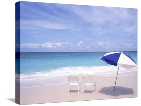 Lounge Chairs and Umbrella on the Beach-Bill Bachmann-Stretched Canvas Print
