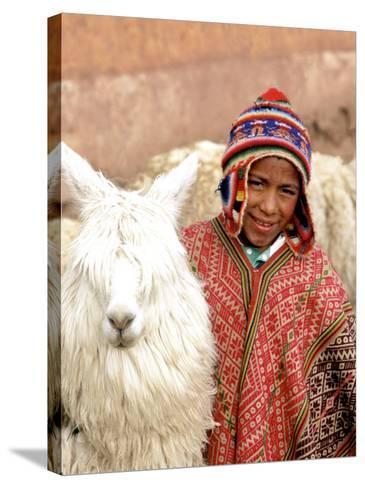 Boy in Costume with Llamas, Cuzco, Peru-Bill Bachmann-Stretched Canvas Print