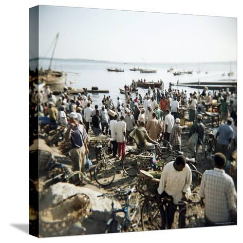 People Waiting on Beach for Dhows to Land Fish, Stone Town, Zanzibar, Tanzania, East Africa, Africa-Lee Frost-Stretched Canvas Print