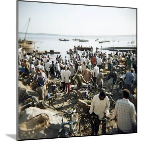People Waiting on Beach for Dhows to Land Fish, Stone Town, Zanzibar, Tanzania, East Africa, Africa-Lee Frost-Mounted Photographic Print