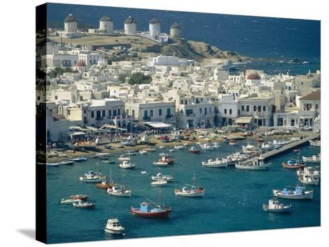 Aerial of the Harbour and Mykonos Town with Windmills in the Background, Greece-Fraser Hall-Stretched Canvas Print