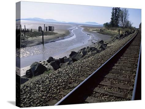 Train Tracks Leading to Bellingham, with San Juan Islands in Distance, Washington State-Aaron McCoy-Stretched Canvas Print