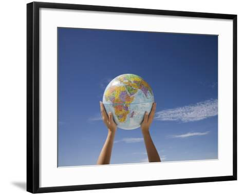 Woman's Hands Holding Globe, Death Valley National Park, California-Angelo Cavalli-Framed Art Print
