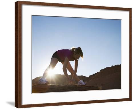Woman Stretching, Monument Valley Navajo Tribal Park, Arizona Utah Border-Angelo Cavalli-Framed Art Print