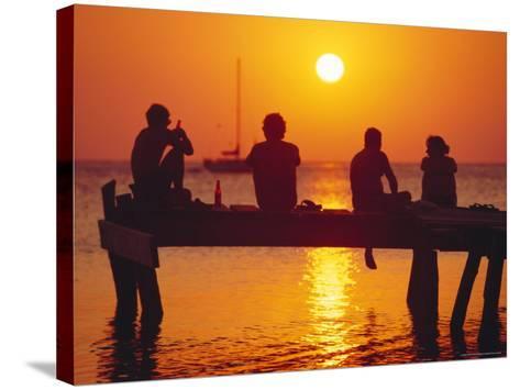 Tourists Enjoying the Sunset, Roatan, Largest of the Bay Islands, Honduras, Caribbean Sea-Robert Francis-Stretched Canvas Print