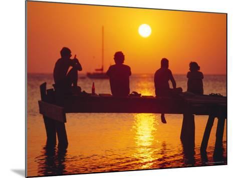 Tourists Enjoying the Sunset, Roatan, Largest of the Bay Islands, Honduras, Caribbean Sea-Robert Francis-Mounted Photographic Print