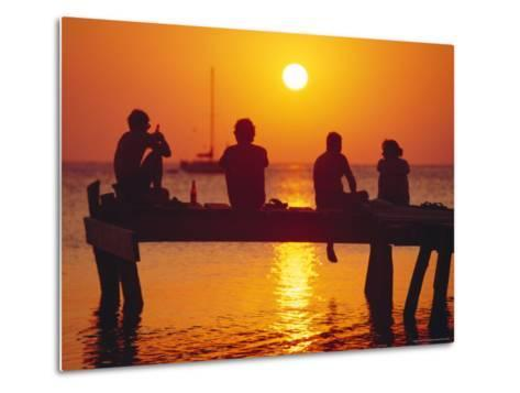 Tourists Enjoying the Sunset, Roatan, Largest of the Bay Islands, Honduras, Caribbean Sea-Robert Francis-Metal Print