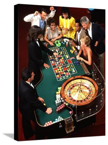 Mixed Ethnic Couples Enjoying Themselves in a Casino-Bill Bachmann-Stretched Canvas Print