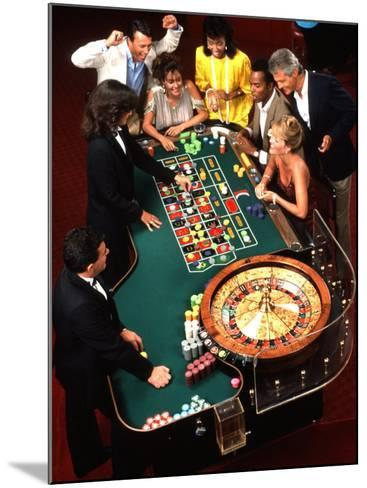 Mixed Ethnic Couples Enjoying Themselves in a Casino-Bill Bachmann-Mounted Photographic Print