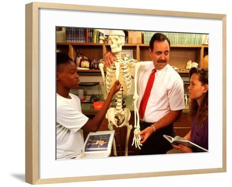 Students with Teacher Examining Skeleton in 7th Grade Science Class-Bill Bachmann-Framed Art Print