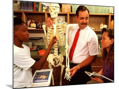 Students with Teacher Examining Skeleton in 7th Grade Science Class-Bill Bachmann-Mounted Photographic Print