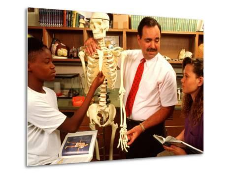 Students with Teacher Examining Skeleton in 7th Grade Science Class-Bill Bachmann-Metal Print