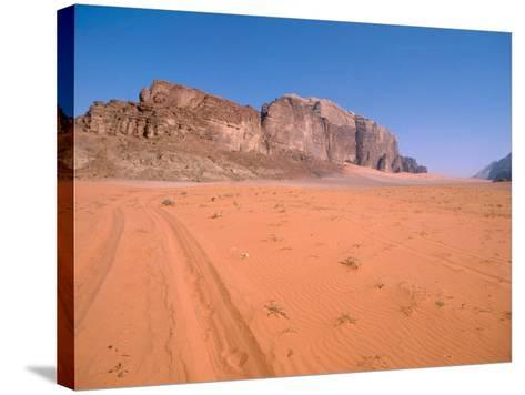Jeep Tracks Across in Desolate Red Desert of Wadi Rum, Jordan-Cindy Miller Hopkins-Stretched Canvas Print