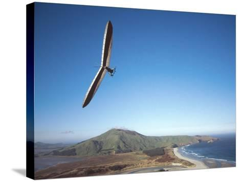 Hang Gliding on Coastline, New Zealand-David Wall-Stretched Canvas Print