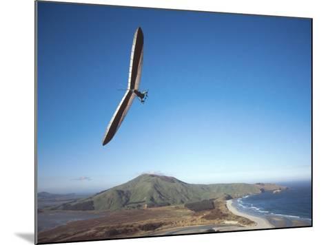Hang Gliding on Coastline, New Zealand-David Wall-Mounted Photographic Print