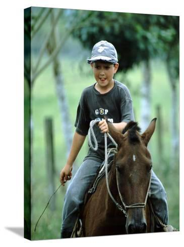 Young Boy Riding Bay Horse and Herding Cattle, Guapiles, Costa Rica-Cindy Miller Hopkins-Stretched Canvas Print
