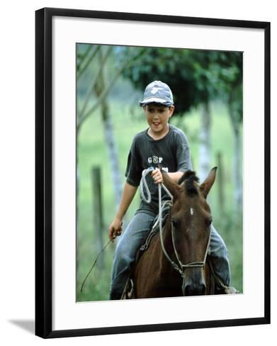 Young Boy Riding Bay Horse and Herding Cattle, Guapiles, Costa Rica-Cindy Miller Hopkins-Framed Art Print