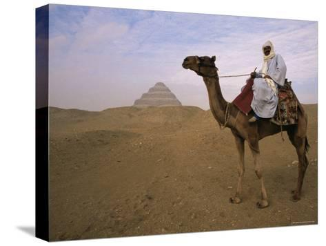 Bedouin Camel Rider in Front of Pyramid of Djoser, Egypt, North Africa-Staffan Widstrand-Stretched Canvas Print