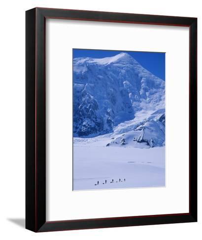 Climbing Expedition Passes Below Mount Forraker in the Alaska Range-Bill Hatcher-Framed Art Print