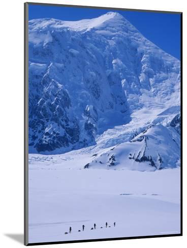 Climbing Expedition Passes Below Mount Forraker in the Alaska Range-Bill Hatcher-Mounted Photographic Print