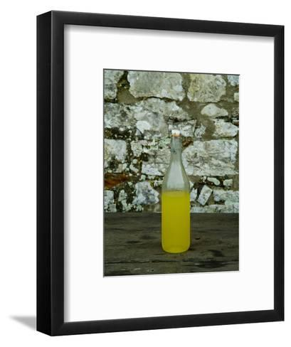 Bottle of Limoncello Sits on a Picnic Table at a Tuscan Villa, Tuscany, Italy-Todd Gipstein-Framed Art Print