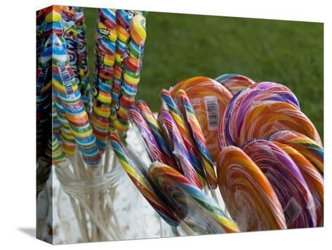 Colorful Lollypops for Sale at a Fair, Mystic, Connecticut-Todd Gipstein-Stretched Canvas Print