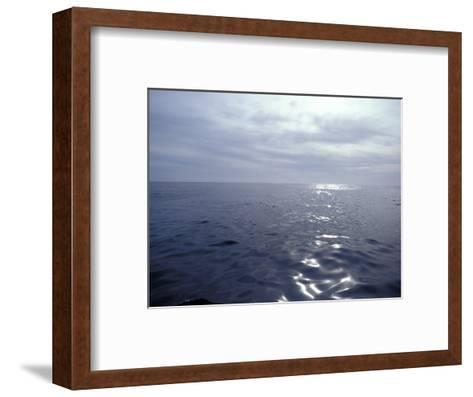 Calm Ocean with Small Ripples Reflects a Sunbeam Off the Surface, Australia-Jason Edwards-Framed Art Print