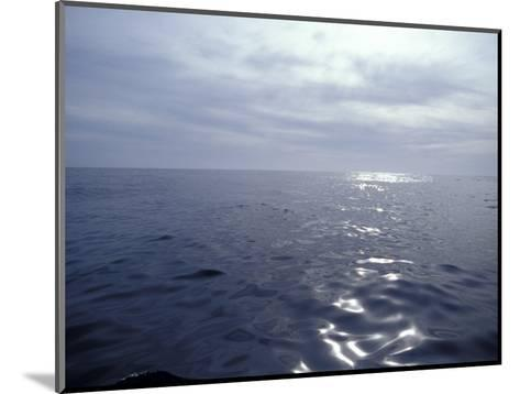 Calm Ocean with Small Ripples Reflects a Sunbeam Off the Surface, Australia-Jason Edwards-Mounted Photographic Print