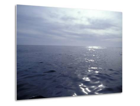 Calm Ocean with Small Ripples Reflects a Sunbeam Off the Surface, Australia-Jason Edwards-Metal Print