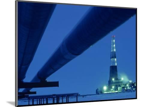 Alaska Oil Pipeline and Oil Rig at Night-Kenneth Garrett-Mounted Photographic Print