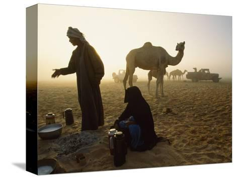 Bedouins Cooking on the Sand at their Camp at Sahamah, Oman-James L^ Stanfield-Stretched Canvas Print