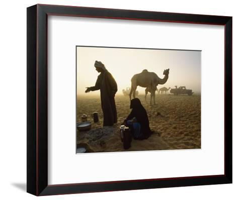 Bedouins Cooking on the Sand at their Camp at Sahamah, Oman-James L^ Stanfield-Framed Art Print