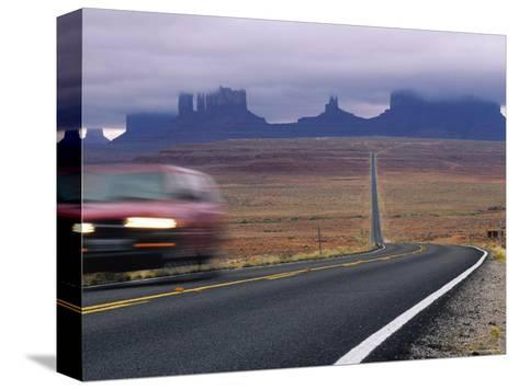 Fog Obscures Monument Valley, Utah-Bill Hatcher-Stretched Canvas Print