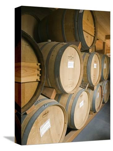 French Oak Barrels of Wine at Midnight Cellars Winery in Paso Robles, California-Rich Reid-Stretched Canvas Print