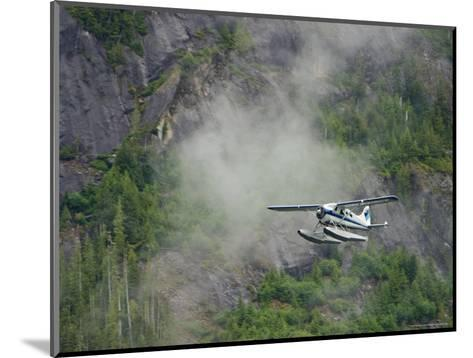 Float Plane against Granite Cliff, Alaska-Ralph Lee Hopkins-Mounted Photographic Print