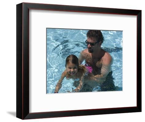 Father Teaches his Child How to Swim, Chevy Chase, Maryland-Stacy Gold-Framed Art Print