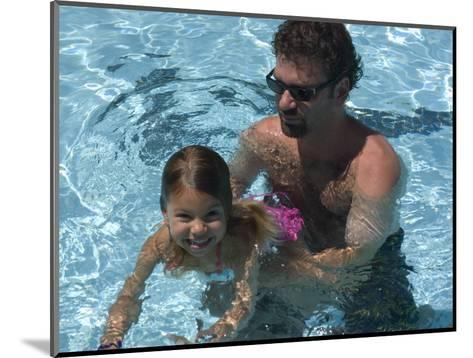Father Teaches his Child How to Swim, Chevy Chase, Maryland-Stacy Gold-Mounted Photographic Print