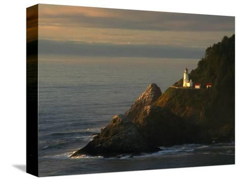 Distant View of the Heceta Head Lighthouse on the Oregon Coast-Phil Schermeister-Stretched Canvas Print
